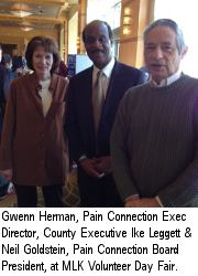 Gwenn Herman, Pain Connection Executive Director, County Executive Ike Leggett and Neil Goldstein, Pain Connection Board President, at Martin Luther King Volunteer Day Fair